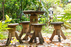 Old wooden table and chairs in the garden Stock Photo