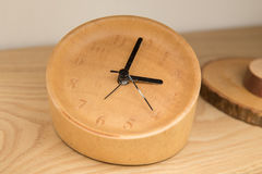 Wooden table clock. Old wooden table clock closeup Royalty Free Stock Images