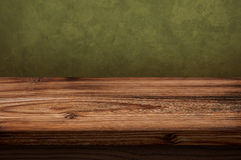 Old wooden table with dark background. Arranged for the material to be placed on a wooden table photo Royalty Free Stock Images