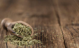 Old wooden table with dried Stevia leaves (selective focus). Old wooden table with dried Stevia leaves (close-up shot; selective focus royalty free stock photography