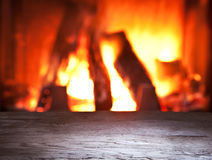 Old wooden table and fireplace. Stock Image