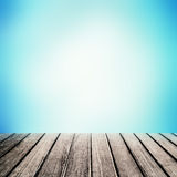 Old wooden table in front blur natural blue sky gradient backdr royalty free stock image