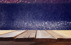 Old wooden table in front of glitter lights background. Image of old wooden table in front of glitter lights background. De-focused. Ready for product display stock photo