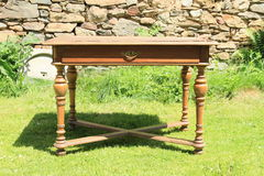 An old wooden table. Made from oak wood standing on grass royalty free stock images