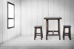 Old wooden table and old wooden chairs in wooden room. Stock Photography