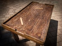 Old wooden table for playing table football stock photography