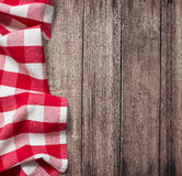 Old wooden table with red picnic tablecloth Royalty Free Stock Photos