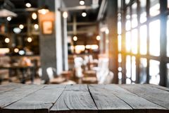 Old wooden table space platform and blurred resturant stock photography