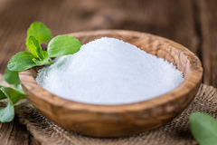 Old wooden table with Stevia Granules (selective focus) Stock Photo