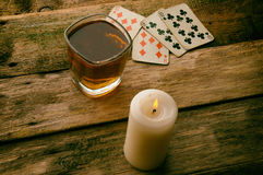 Old wooden table to play cards Stock Photos