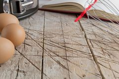 Old wooden table with utensils Royalty Free Stock Photo