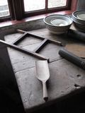 Old wooden table with utensils by window serene light royalty free stock photos