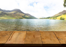 Old wooden table or walkway by lake Royalty Free Stock Images
