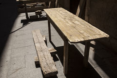 Old wooden tables at an outdoor cafe . Royalty Free Stock Image