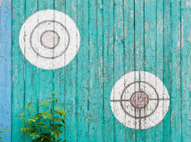 Old wooden targets on the fence. Old wooden targets on the turquoise fence royalty free stock images