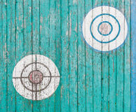 Old wooden targets on the fence. Old wooden targets on the turquoise fence Stock Photo