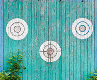 Old wooden targets on the fence. Old wooden targets on the turquoise fence Stock Photos