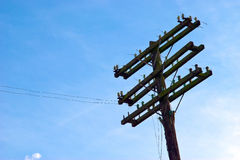 Old wooden telephone pole. Details of the cross arms of and old, wooden telephone or telegraph pole Royalty Free Stock Photo