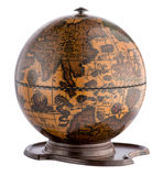 Old wooden terrestrial globe on a plinth. Showing the oceans , continents, tall ships and sea creatures isolated on white Stock Photos