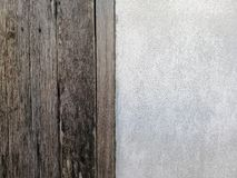 Old Wooden texture with white concrete texture background Used for placing banner on concrete wall. stock photo