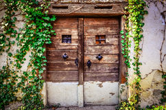 Old wooden textured door and weathered wall Royalty Free Stock Images
