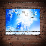 Old wooden textures with rusty barbed and sky Stock Image