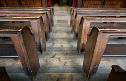 Old wooden tiered church pews from above - image stock photo