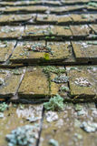 Old wooden tiles roof Stock Photos
