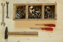 Old wooden toolbox with tools stock photography