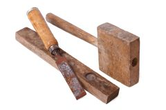 Old wooden tools chisel, a hammer and a level isolated Stock Photos