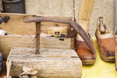 Old wooden tools to work the footwear. In an artisan way royalty free stock images