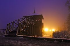Old wooden tower. Sprinkled with the first snow and fogged out Stock Photography