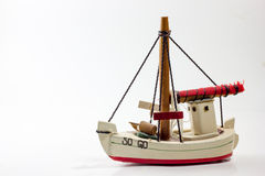 Old wooden toy boat. White gird red Stock Image