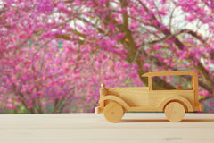 Old wooden toy car over wooden table. Royalty Free Stock Photography