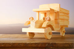 Old wooden toy car over wooden table. nostalgia and simplicity concept. vintage style image Royalty Free Stock Images