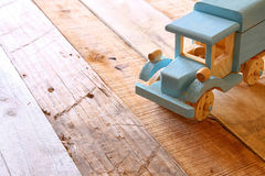 Old wooden toy car over wooden table Royalty Free Stock Image