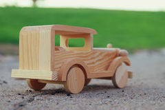 old wooden toy car on the road outdoors in the park Royalty Free Stock Photography