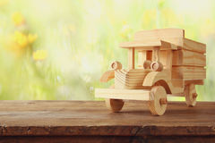 old wooden toy truck car over wooden table Stock Photo
