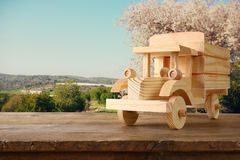 old wooden toy truck car over wooden table Royalty Free Stock Image