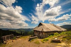 Old wooden traditional house in the mountains Stock Photos
