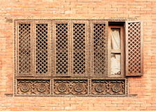 Old wooden traditional Nepalese window detail. Royalty Free Stock Photos