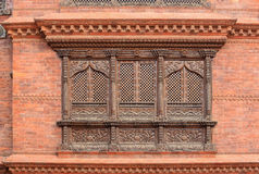 Old wooden traditional Nepalese window detail. Nepal Royalty Free Stock Image