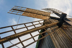 Old wooden traditional ukrainian windmill Stock Photos