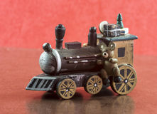 Old wooden train with presents and teddy Royalty Free Stock Images