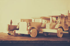 Old wooden transportation toys: train, car and track on wooden table. vintage filtered and toned Royalty Free Stock Photography