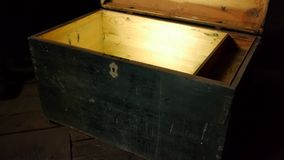 Old wooden treasure chest with strong glow from inside stock footage