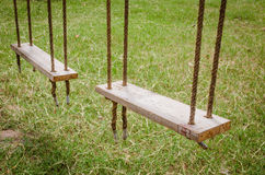 Old wooden tree swing Stock Photos