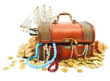 Old wooden trunk with money and jewellery isolated Stock Images