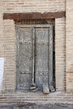 Old wooden tumbledown door in the Central Asian style. Bukhara, Uzbekistan Stock Photos