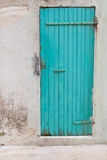 An old wooden turquoise or green door in a old house. Royalty Free Stock Photography